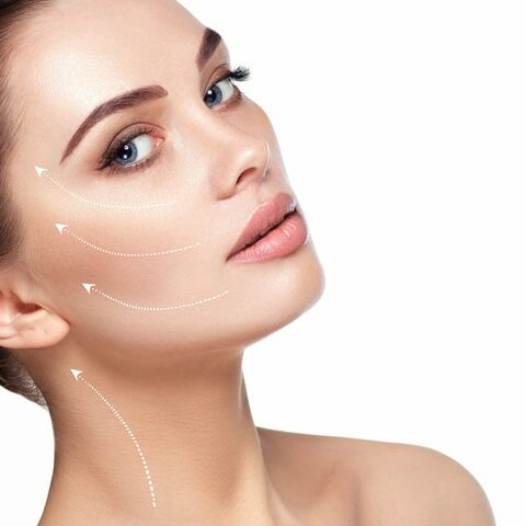 portrait of beautiful woman with perfect skin of the face, with arrows on face, concept of lifting skin. Cosmetology, elastic and young skin of the face. (portrait of beautiful woman with perfect skin of the face, with arrows on face, concept of lifti